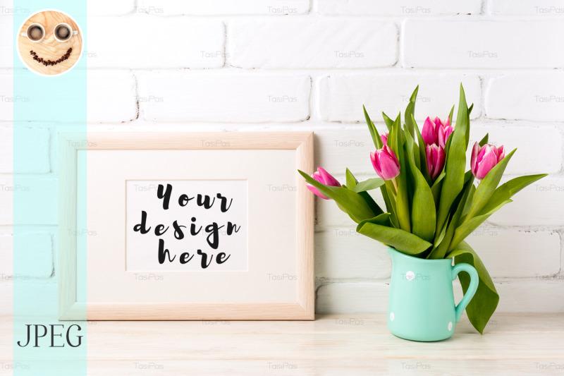 Free Wooden landscape frame mockup with pink tulips in jug (PSD Mockups)