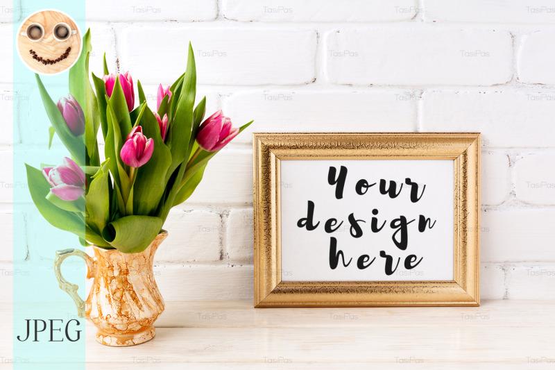Free Golden landscape frame mockup with pink tulips in jug (PSD Mockups)