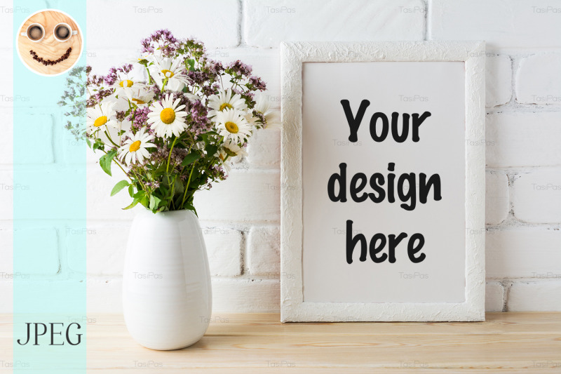 Free White frame mockup with blooming wildflower bouquet near painted brick (PSD Mockups)