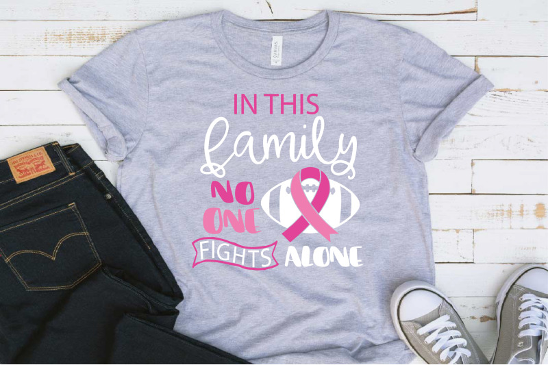 in-this-family-nobody-fights-alone-breast-cancer-football-svg-1521s