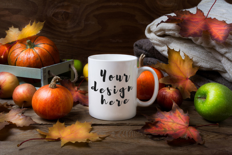 white-coffee-mug-mockup-with-fall-leaves-pumpkins