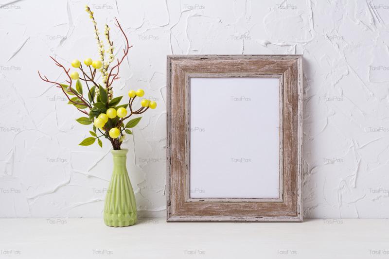 rustic-wooden-frame-mockup-with-green-vase