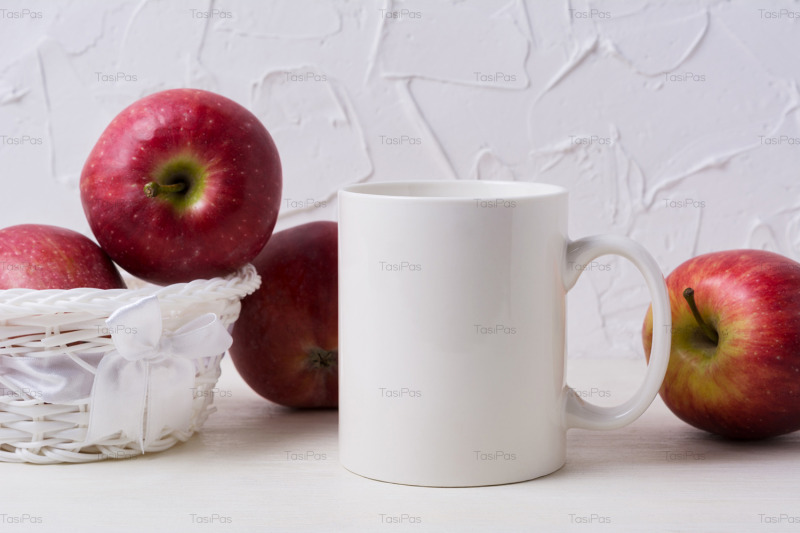 white-coffee-mug-mockup-with-red-apples-in-wicker-basket