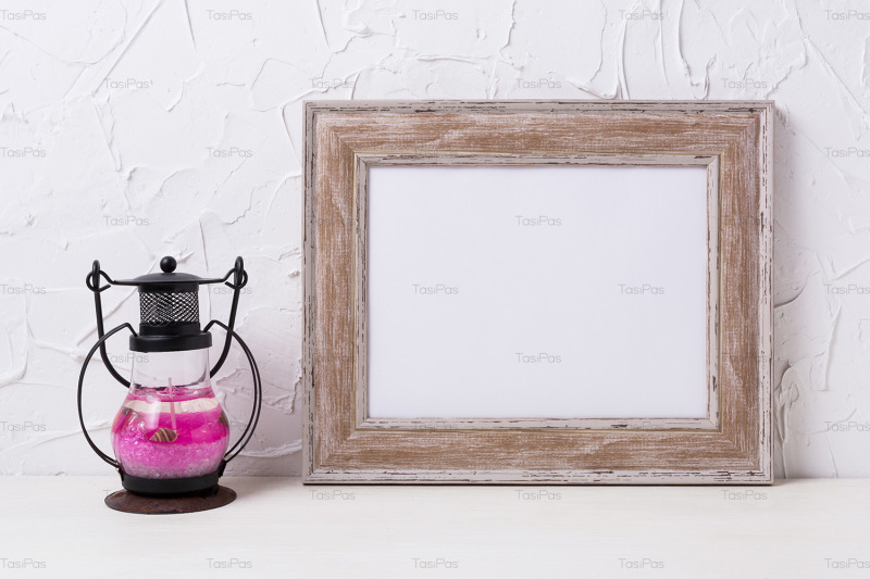 rustic-wooden-landscape-frame-mockup-with-metal-candle-lantern