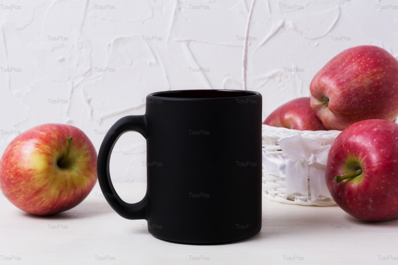 black-coffee-mug-mockup-with-apples-in-white-basket