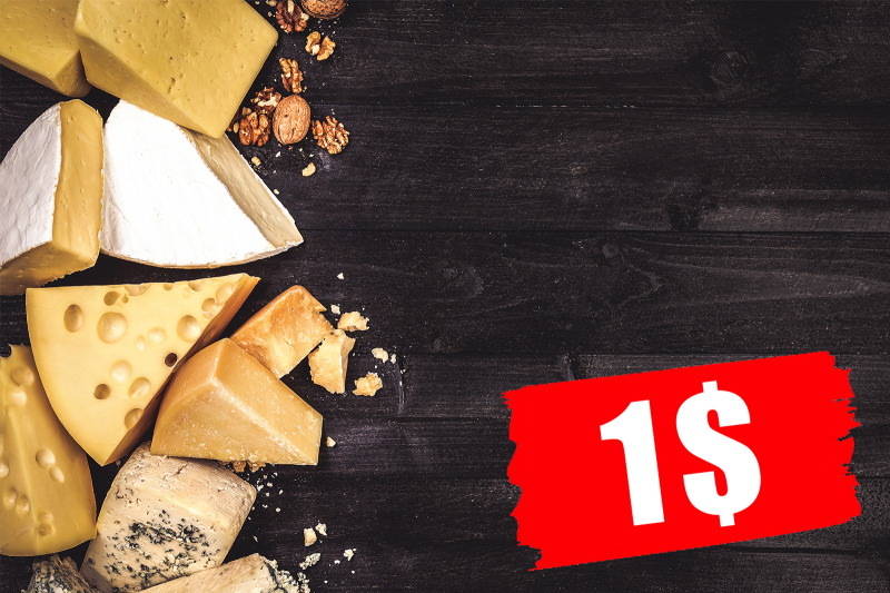 various-types-of-cheese-on-black-wooden-background-with-copy-space