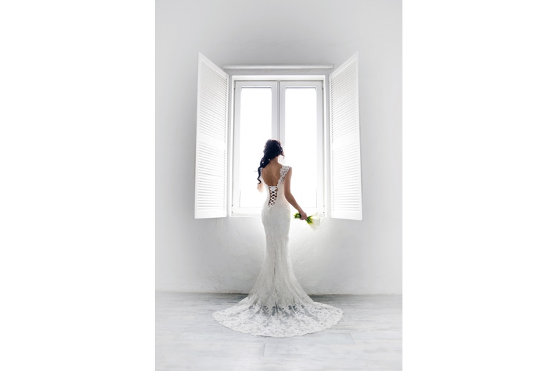 bride-in-a-white-room-by-the-window