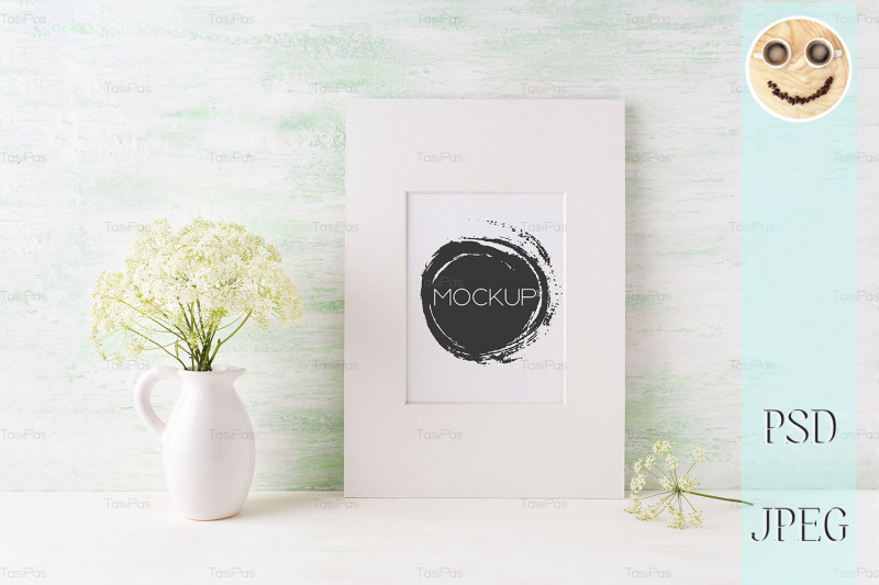 easy-white-frame-mockup-with-tender-wild-flowers-in-pitcher