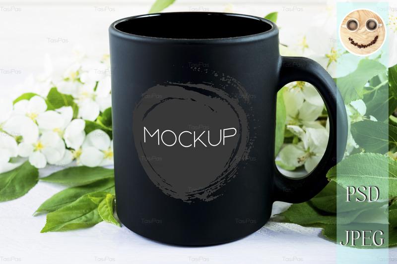 black-coffee-mug-mockup-with-apple-blossom