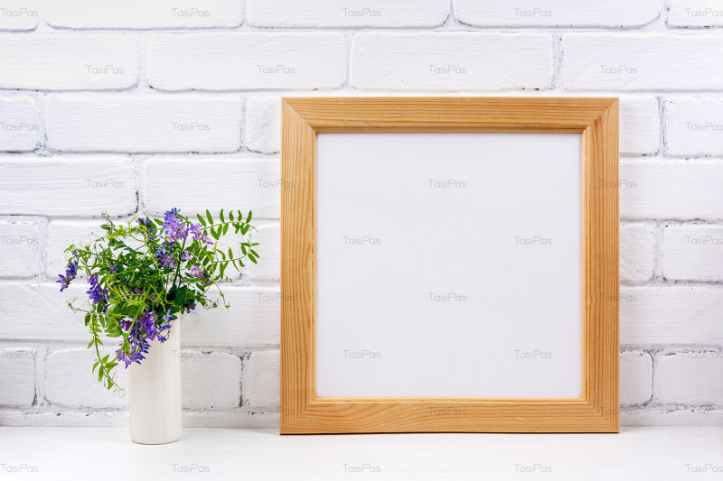 square-wooden-picture-frame-mockup-with-bird-vetch