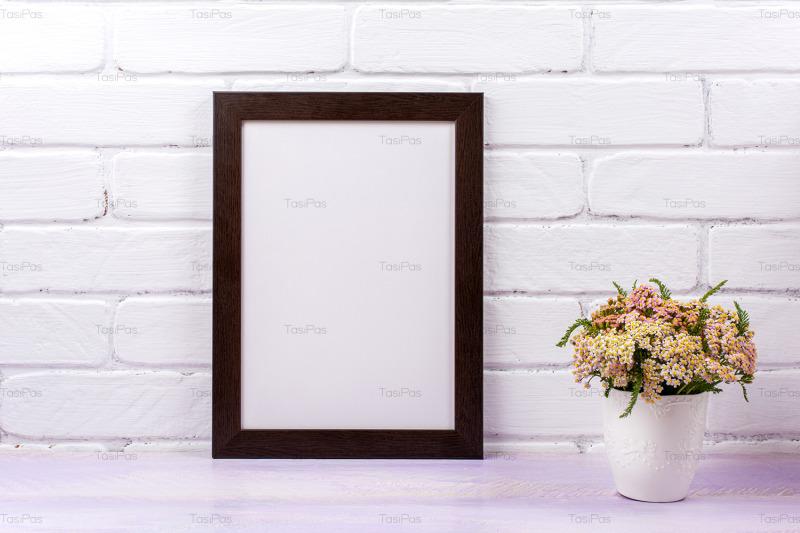 black-brown-poster-frame-mockup-with-pink-yarrow