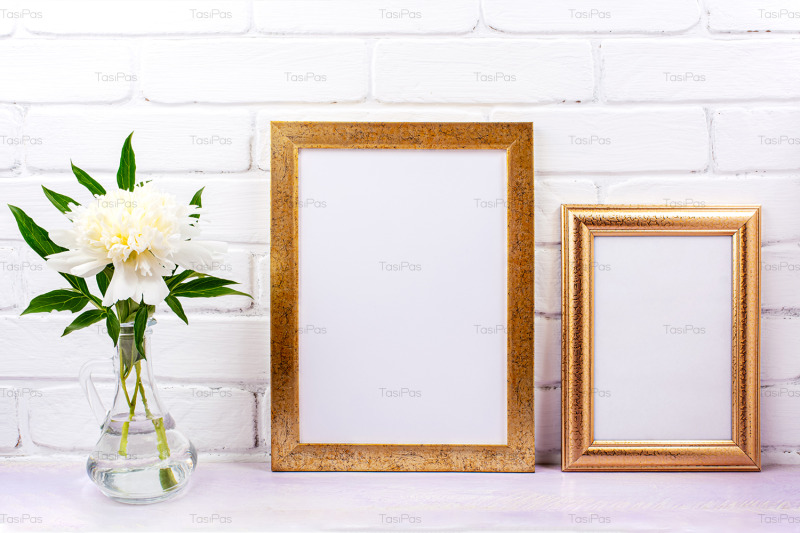 two-golden-poster-frames-mockup-with-white-peony
