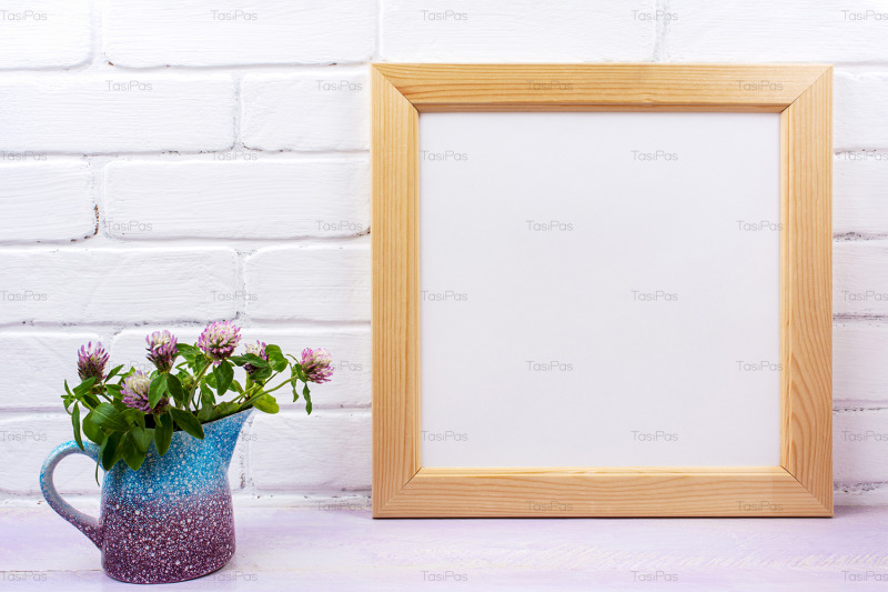 wooden-square-picture-frame-mockup-with-pink-clover