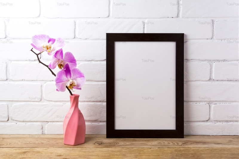 black-brown-poster-frame-mockup-with-pink-orchid