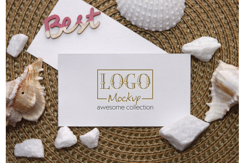 logo-mockup-on-white-stones-and-seashels-design