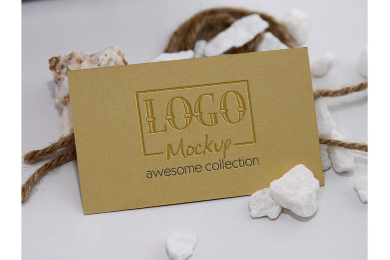 logo-mockup-with-white-stones-and-seashels-design
