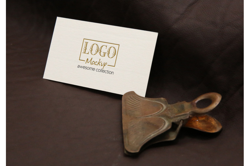 logo-mockup-with-vintage-clip-on-leather-background