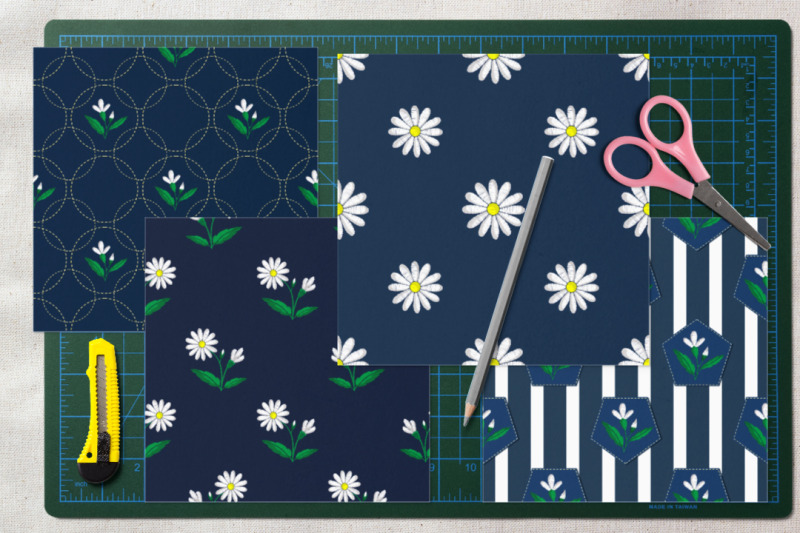 embroidered-daisies-on-a-blue-background