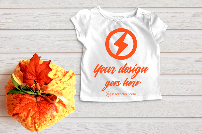 folded-tee-with-fall-pumpkin-png-mock-up