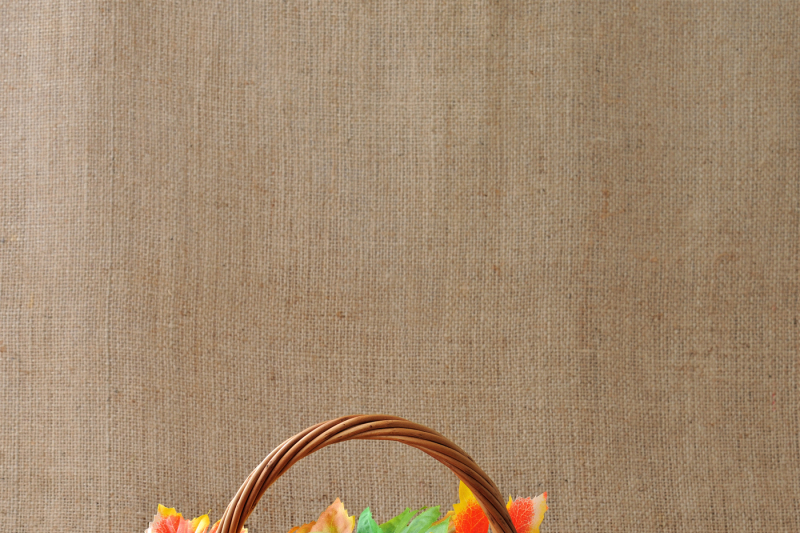 basket-of-apples-with-autumn-leaves