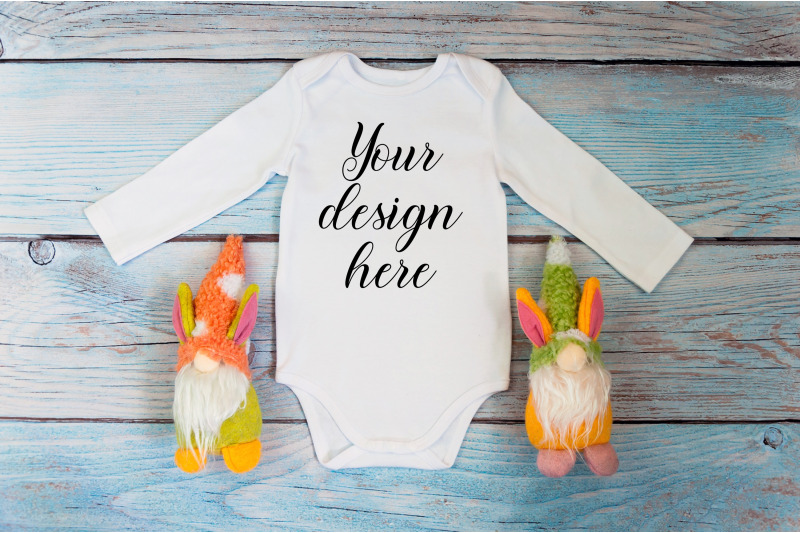 baby-bodysuit-mockup-with-gnome-toy-on-a-wooden-background