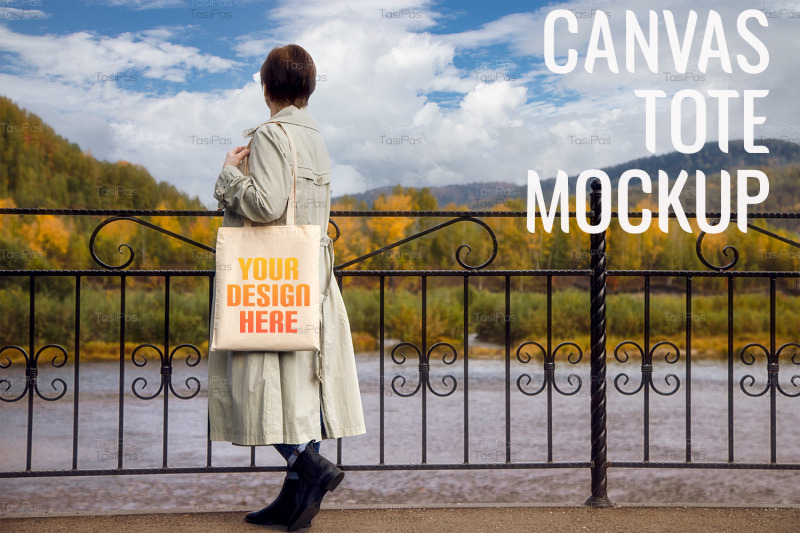 woman-in-classic-trench-coat-holding-tote-bag-mockup