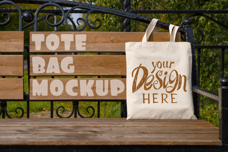 rustic-tote-bag-on-the-garden-bench-mockup