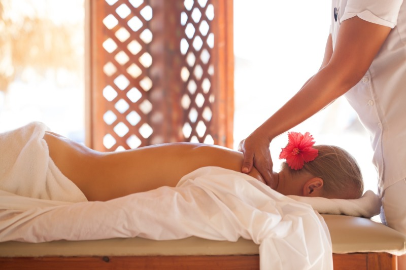 woman-relaxing-with-body-massage-at-beauty-spa