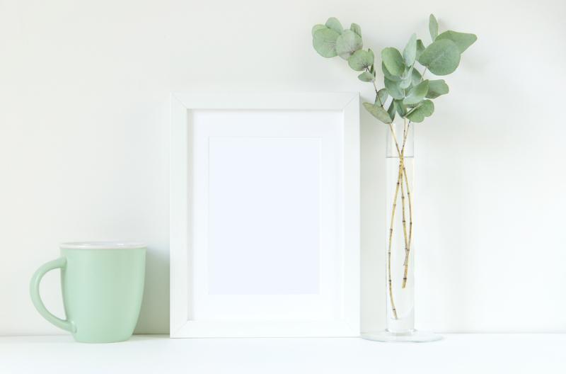 Free Styled stock white frame mockup with eucalyptus (PSD Mockups)