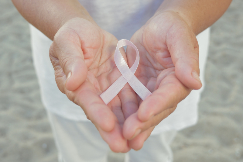 hands-holding-pink-ribbon