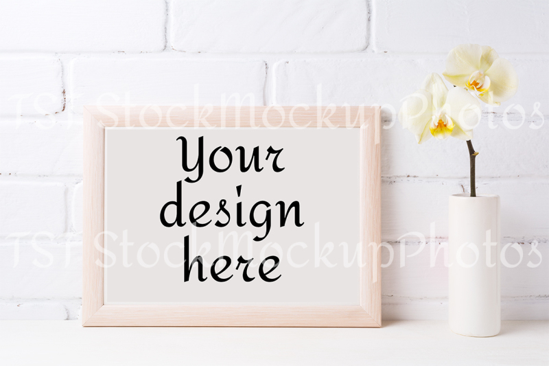 wooden-landscape-frame-mockup-with-soft-yellow-orchid-in-vase