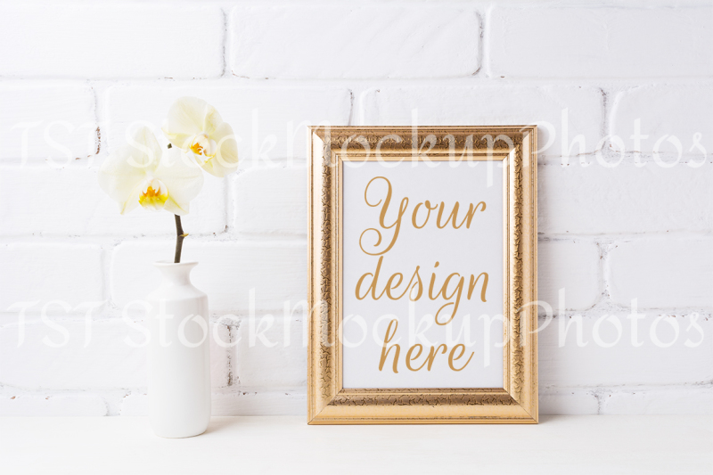 Free Golden frame mockup with soft yellow orchid in vase (PSD Mockups)