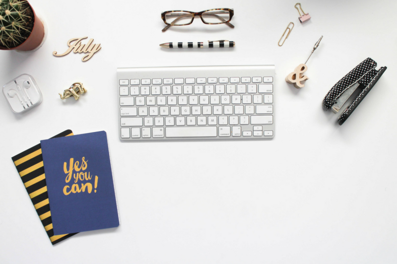 july-desktop-flatlay-with-journals