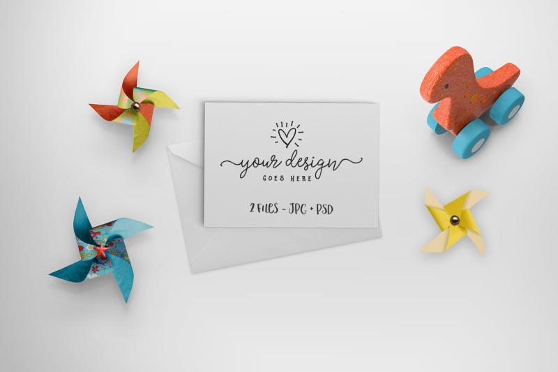 Free Greeting Card mockup with dino & pinwheels 25-009 (PSD Mockups)