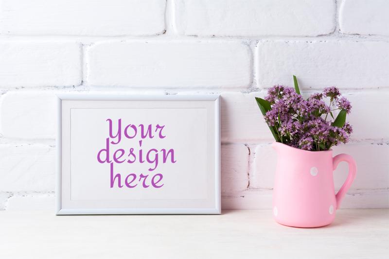 Free White landscape frame mockup with purple flowers in polka dot pink pitcher (PSD Mockups)