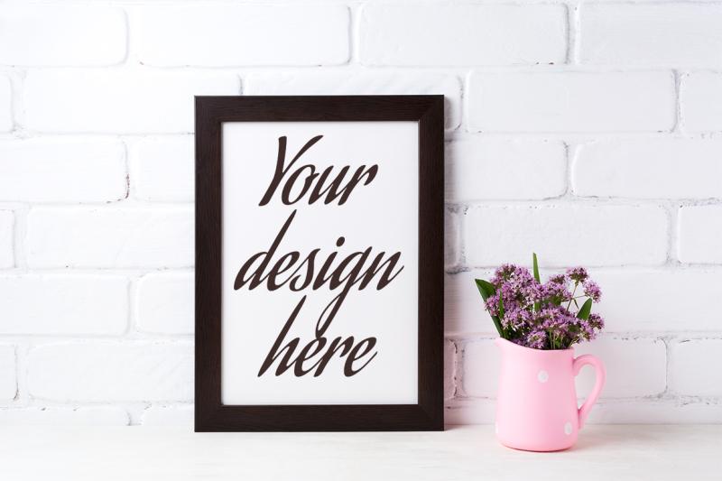 Download Black brown frame mockup with purple flowers in polka dot pink pitcher Free Mockups