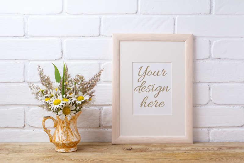 Free Wooden frame mockup with chamomile and grass in golden pitcher. (PSD Mockups)