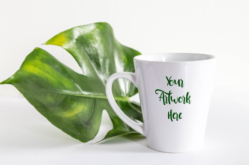 Free Latte Mug mockup with Monstera Leaf (PSD Mockups)